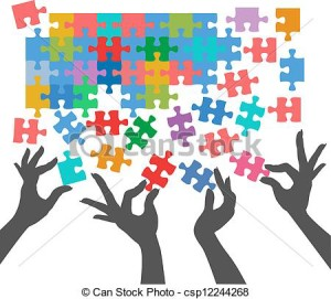 Hands Arranging Puzzle Pieces